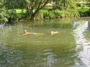 swimming in the river by motorhome aire