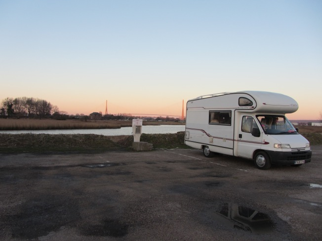 The Motorhome aire at Honfleur with the Normandy Bridge in the background