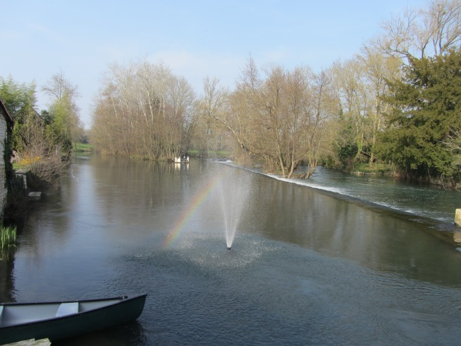 Beautiful water display and rainbow by watermill