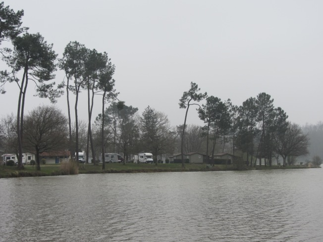 Our pitch and motorhome seen from the opposite side of lake