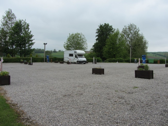 The motorhome aire with the pitches separated by flower containers