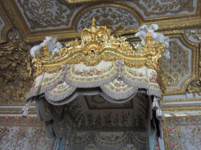 The luxurious canopy over the Queen's bed