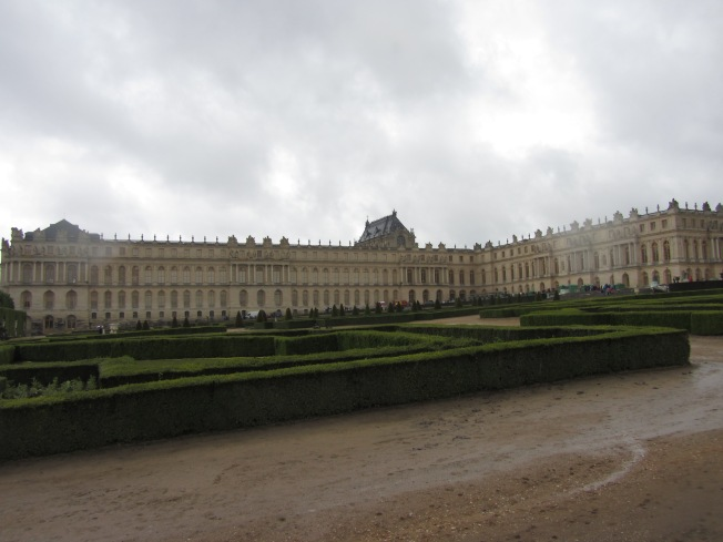 The palace viewed from the gardens on a rainy day