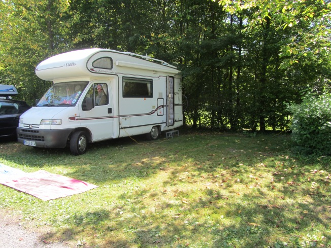 Our shaded and generous pitch at Camping Lac de Carouge
