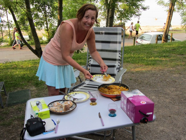 Enjoying a paella on our generous pitch so near the lake