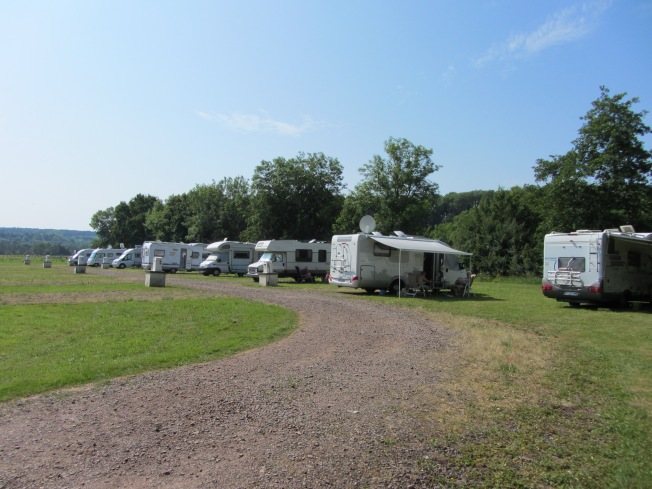 The roomy motorhome aire at Corre by river and Marina