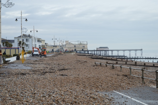 The promenade covered by shingle after the storm