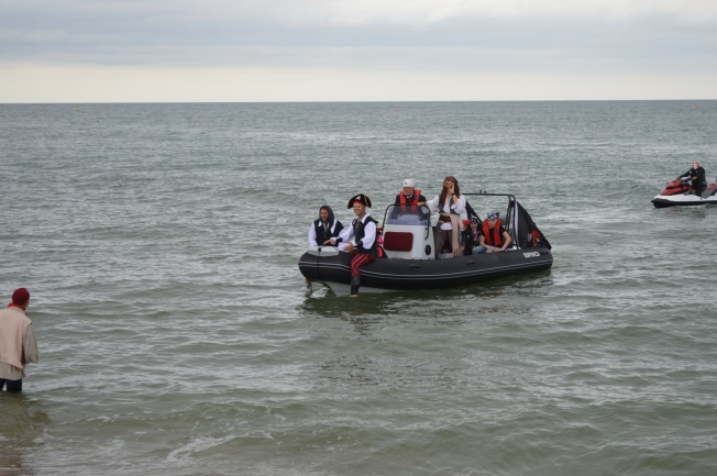 The Captain arriving on Bognor Regis Beach in a modern age Black Pearl