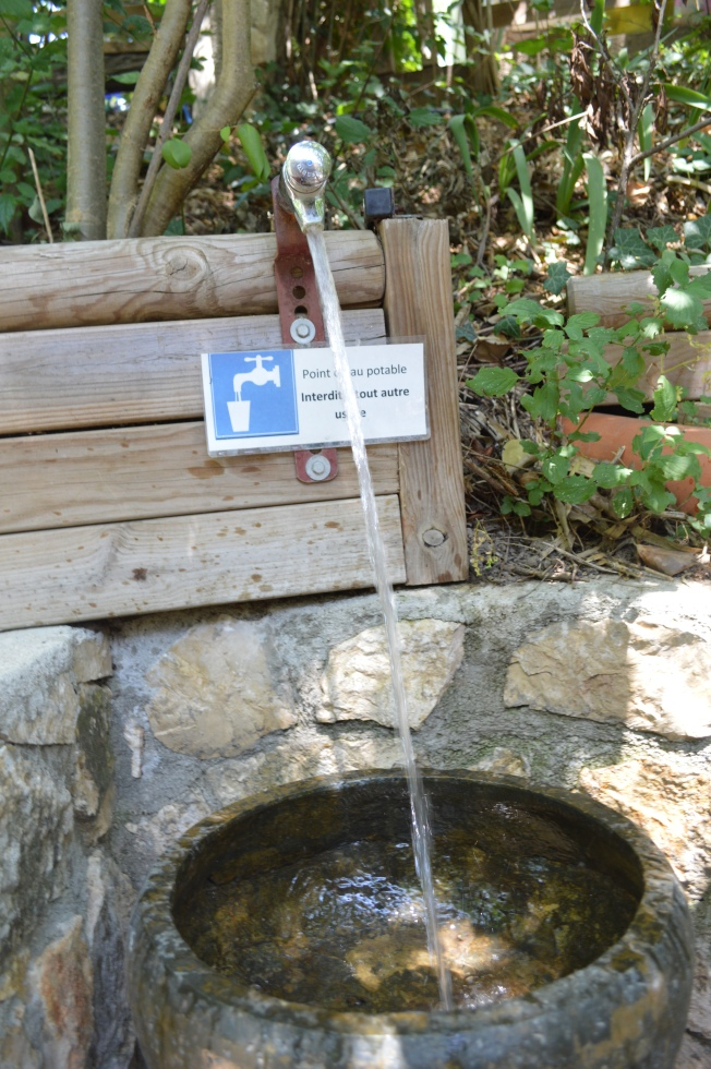 Our very own water fountain with stone basin
