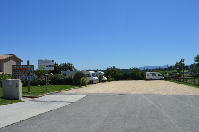 The full site of the motorhome aire at Boulieu-les-Annonay with free water facilities and services on left