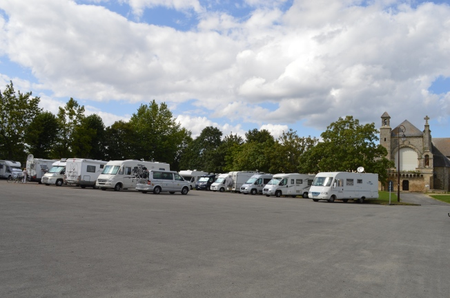 The busy but free motorhome aire at Josselin by St Martin's Church