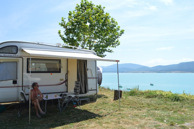 Sheltering from the heat at our pitch at the camping of Embalse de Yesa