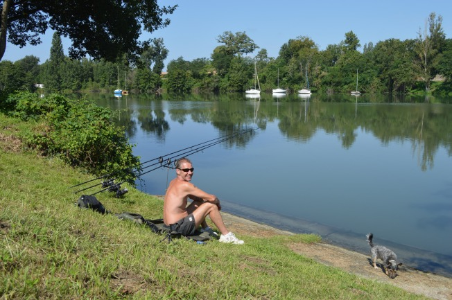 A happy Adonis fishing at the Plan d'eau de Rieux-Volvestre