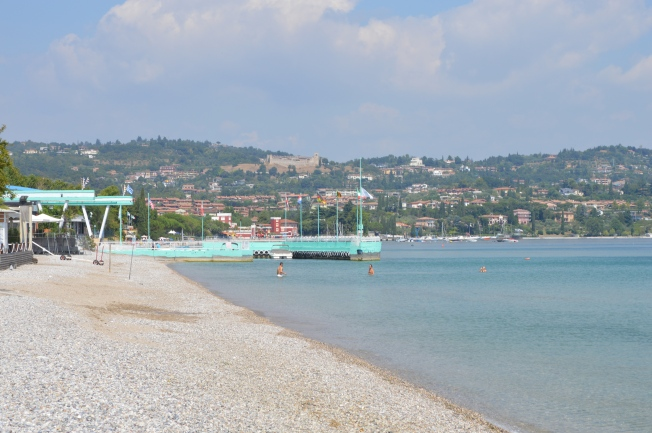 The nearly deserted lake Garda and beach in the morning